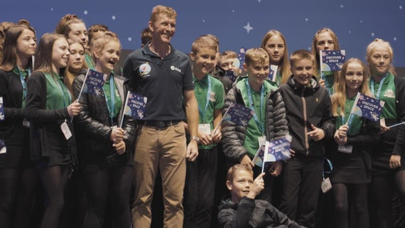 Pupils prepare to have their picture taken with UK astronaut Tim Peake.