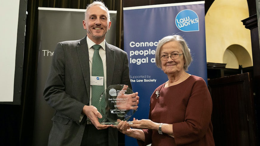 Professor Jason Tucker collects the Best Contribution by a Pro Bono clinic award from Baroness Hale