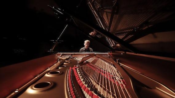 Professor Kenneth Hamilton playing a piano