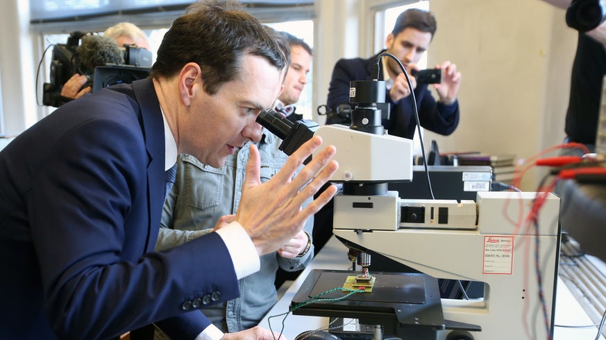 George Osbourne looking through a microscope