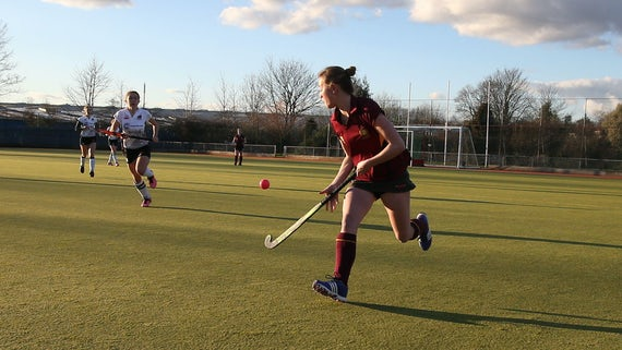 Students playing hockey