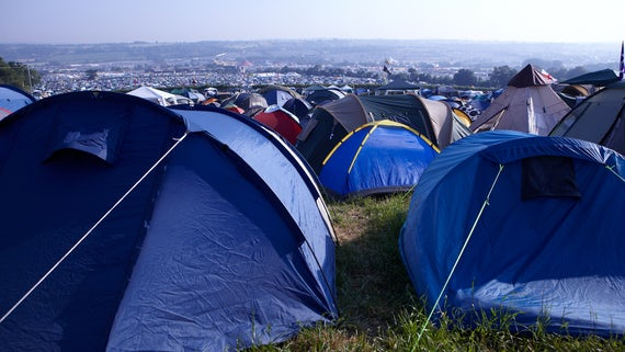 Stock image of tents at a festival