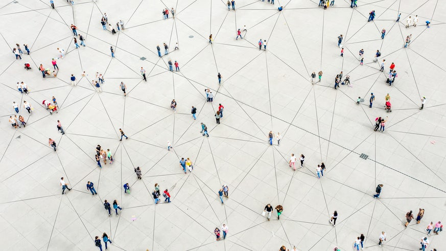 Aerial view of crowd connected by lines - stock photo