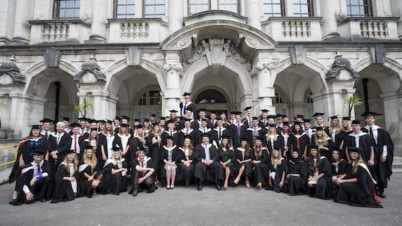 Group photo of graduating students outside Main Building