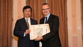 Dr Christopher Hood is presented with his Certificate of Commendation by the Ambassador of Japan, Koji Tsuruoka.