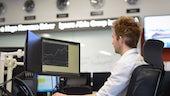 Man sat at computer terminal