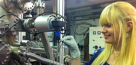 Research student sets up an ultra high vacuum evaporator