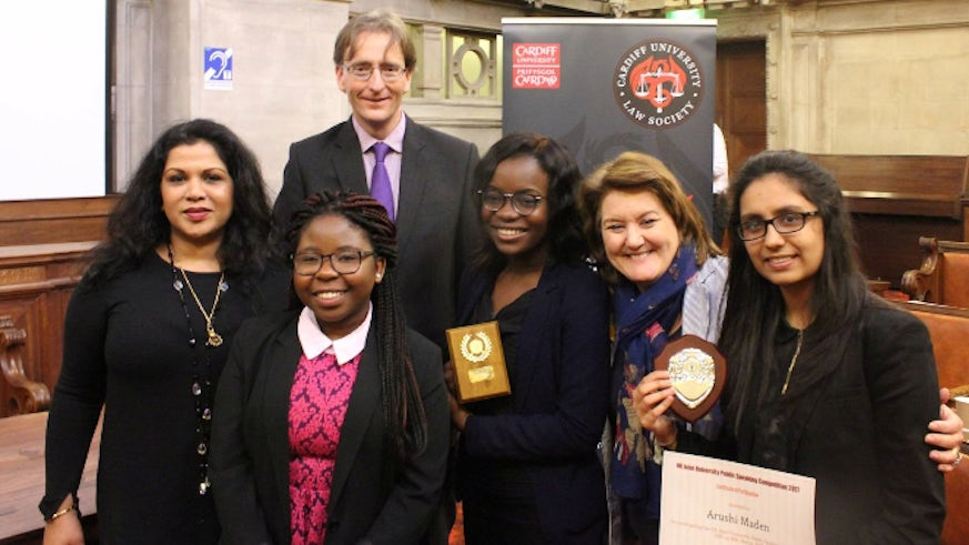 The winners and judges celebrate at the Public Speaking Competition.
