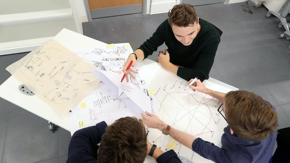 Architecture students sketching plans in seminar