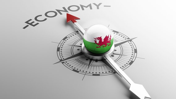 Compass with Welsh economy concept