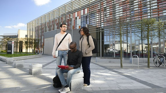 Postgraduate students outside Haydn Ellis building