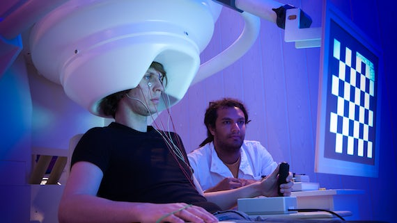 showing brain imaging equipment on patient