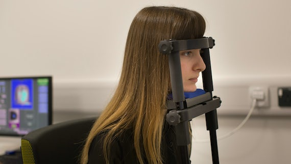 Woman with her head in a cognitive testing device