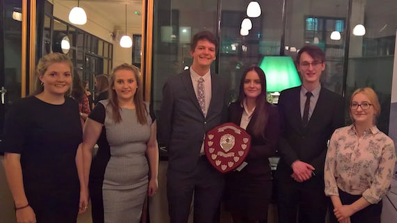Cardiff students Charles Wilson and Sophie Rudd (centre) with their fellow finalists at the National Negotiation Competition.