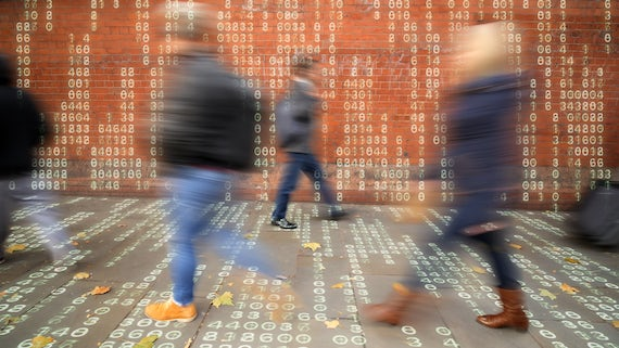 Image of people walking about in a world surrounded by streams of data