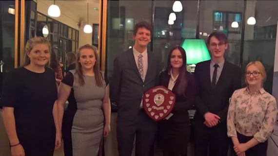 Cardiff students Charles Wilson and Sophie Rudd (centre) with their fellow finalists at the National Negotiation Competition which took place earlier this year.