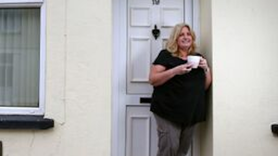 Female resident merthyr holding cup of tea