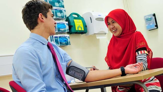 Students taking blood pressure