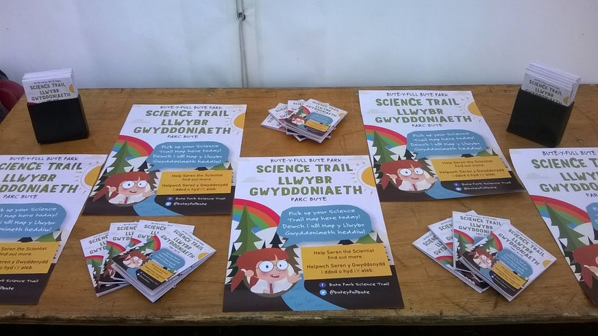 Science trail posters on a table