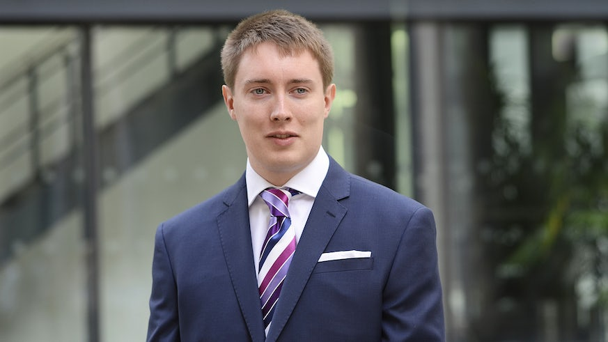 Image of Ross Raftery in a suit and looking towards the camera