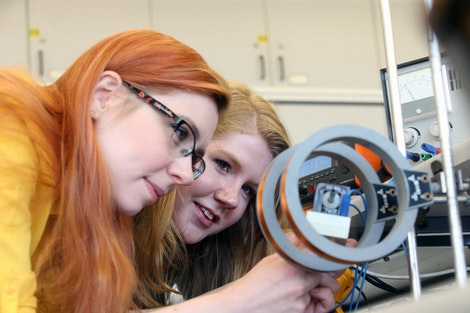 Two students working in the UG Physics lab.