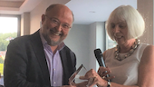 Professor Mike Levi receiving his outstanding achievement award from Professor Sandra Walklate