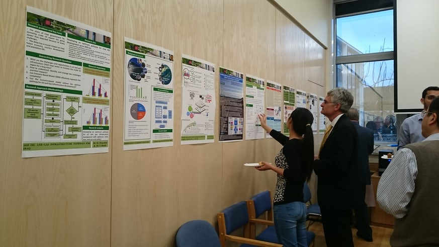 PhD student discussing poster