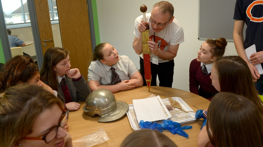 Dr David Wyatt with pupils from Cardiff West Community High School