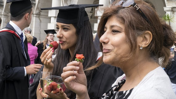 Graduation guests eating strawberries