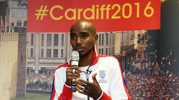 Mo Farah speaking to South Wales school children before the World Half Marathon Championships in Cardiff.