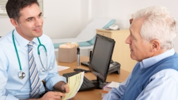 doctor talking to an older man