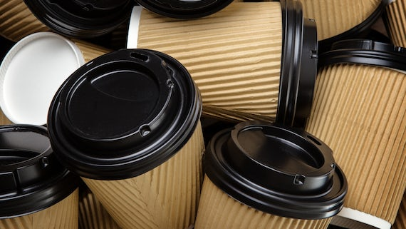 A pile of disposable coffee cups