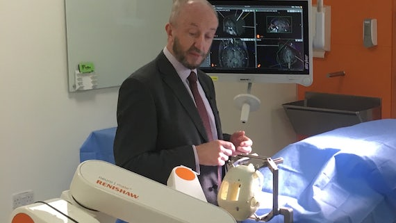 Professor William Gray performing procedure with Neuromate