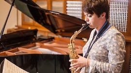 Student at Cardiff University School of Music playing the saxophone