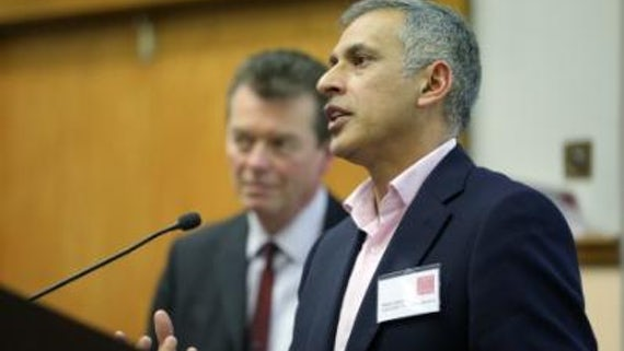 Abdul Rahim speaking at a Vision2020 network event, with Jasper Hemmes standing behind