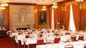 Tables laid for dinner in Glamorgan Building