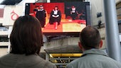Graduation being shown in Cardiff city centre