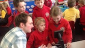 Dr Ian Humphreys working with children from St Brides Major Primary School in Bridgend.