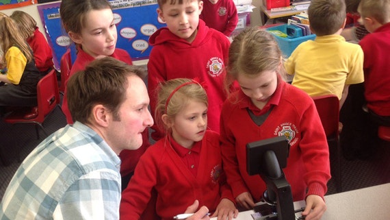 Dr Ian Humphreys working with children from St Brides Major Primary School in Bridgend.