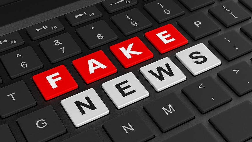 A keyboard with keys spelling fake news