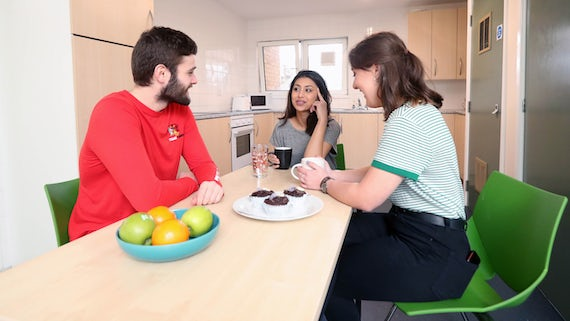 Students sitting in a typical kitchen in a self-catered student residence at Cardiff University