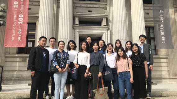 Students from Beijing Normal University standing outside Glamorgan Building, Cardiff University