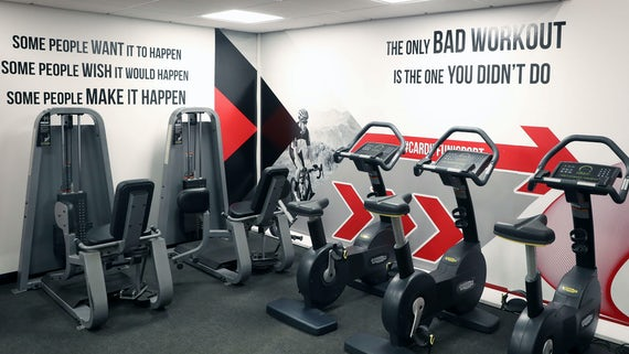 Exercise bikes with inspirational quotes on the wall.