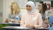 A pupil at Creative Multilingualism Day smiles at the camera