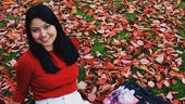 Filipino student Gabriela Caganda sitting on the grass