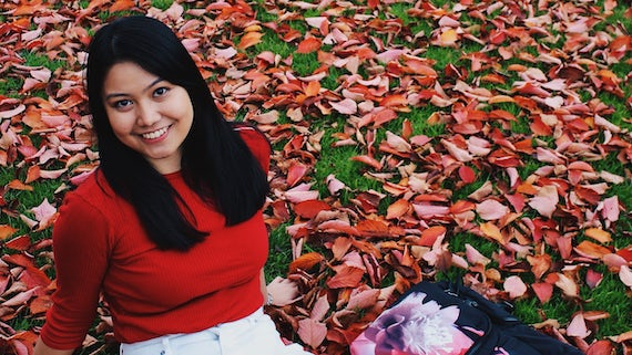 Filipino student Gabriela Caganda sitting on the grass