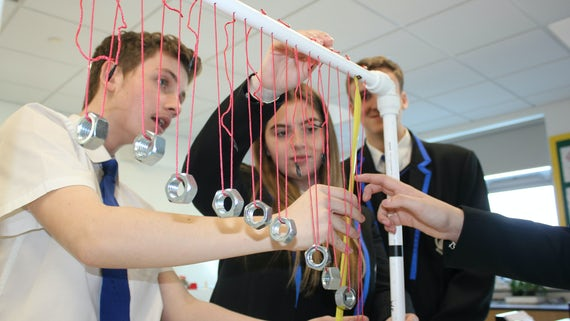 Students taking part in physics lesson 2