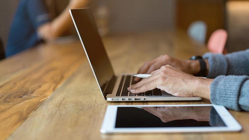Image of person using laptop