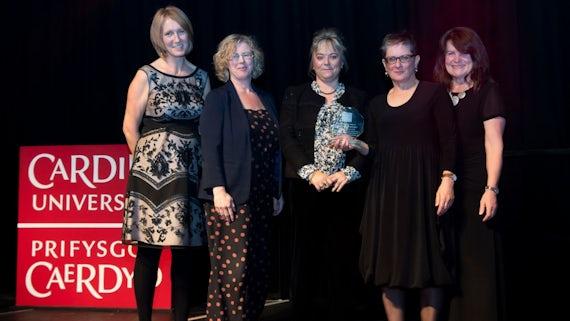 Group of women receive award