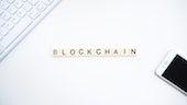Blockchain spelled on Scrabble tiles
